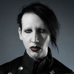 Brian Warner, professionally known as Marilyn Manson, has white skin, black hair, dark makeup, and one iris brown while the other is very light blue.